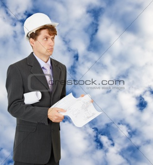 Engineer - builder on background of cloudy sky