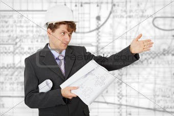 Engineer in a helmet pointing direction