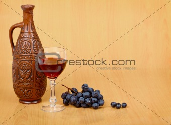 Artistic composition - crock, glass and grapes