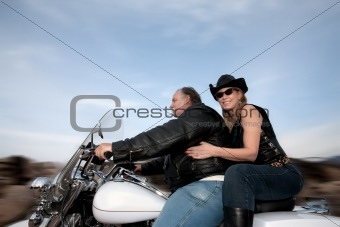 Couple riding a motorcycle