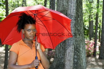 Black Woman Holding an Umbrella