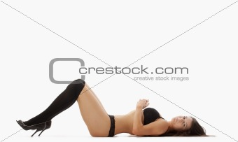 beautiful young woman in black underwear and stockings - isolated on white