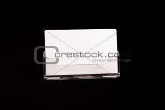 Card holder on black background