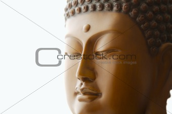 Close up of Buddha head carving