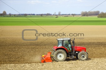 a tractor cultivating