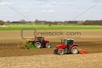 two tractors crossing in a field