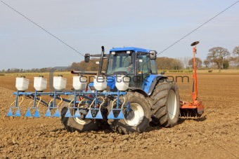 applying granular pesticide and cultivating
