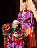 Navajo Women in Traditional Clothing Who Are Mother and Daughter