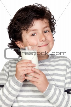 Beautiful child with glass of milk