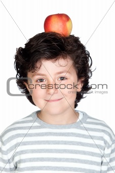 Beautiful child with a apple on his head