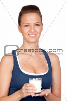 Attractive girl with glass of milk