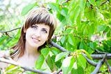 Beautiful girl between the trees
