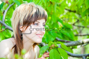 Beautiful girl between the trees