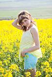 Girl in a rapeseed field
