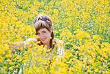 Girl in a rapeseed field