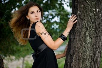 Beautiful woman near the tree