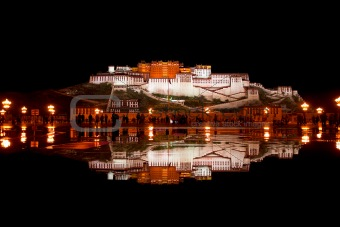 Potala Palace and reflection in pool of water.