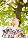young woman in park, smiling