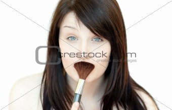 Beautiful woman holding a powder brush