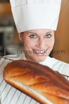 Smiling female chef baking bread