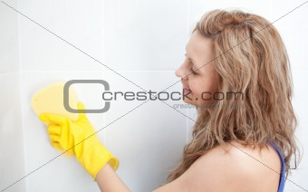 an housewife cleaning a wall