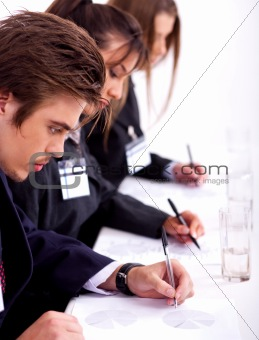 business team taking notes