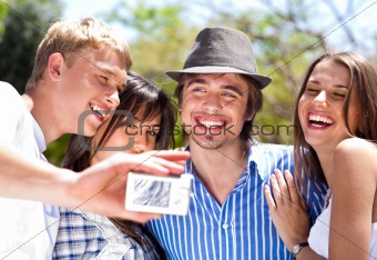 group of happy smiling couples taking picture together
