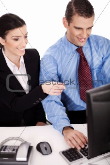 Business women pointing something on their computer