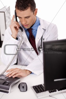 adult  physician sitting at his desk