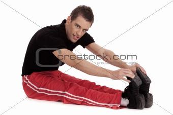 Fitness men stretches his leg