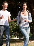 Young couple running in the prak