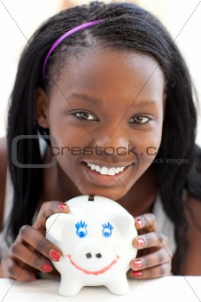 Bright teen girl holding a piggy-bank
