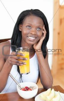 Charming Afro-American having breakfast