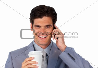 Positive businessman on phone and drinking a coffee