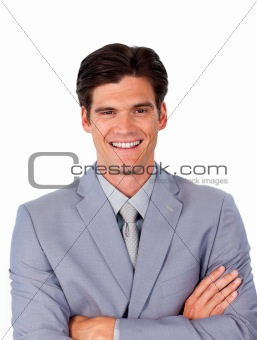 Smiling assertive businessman with folded arms