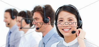 Portrait of smiling customer service agents working in a call ce
