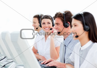 Portrait of enthusiastic customer service agents working in a ca