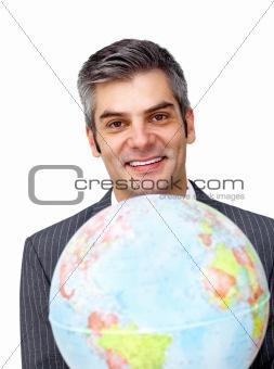 Charisatic businessman holding a terrestrial globe