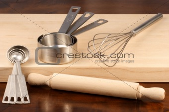 kitchen utensils over wood
