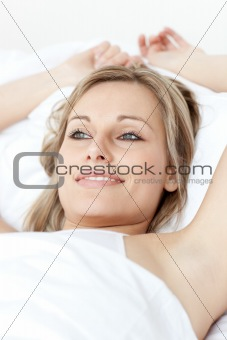 Charming woman relaxing  lying on a bed