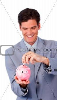 Smiling businessman saving money in a piggy-bank