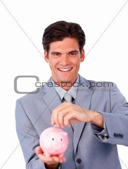 Charismatic businessman saving money in a piggy-bank