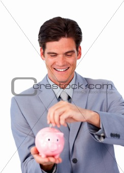 Assertive businessman saving money in a piggy-bank