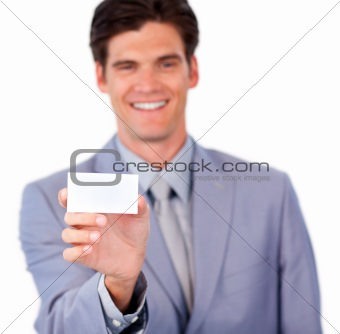 Positive businessman holding a white card