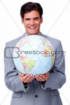 Charismatic businessman holding a terrestrial globe