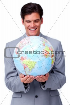 business man holding a globe in white background