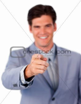 Positive businessman pointing at the camera