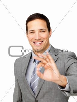 Charming businessman showing OK sign