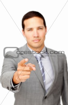 Serious businessman pointing at the camera 