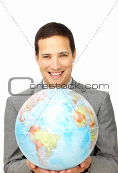 Attractive businessman holding a terrestrial globe